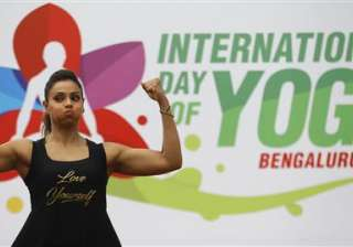 Bollywood actress Bipasha Basu laughs as she performs yoga at an event to celebrate International Yoga Day in Bangalore. Millions of yoga enthusiasts are bending their bodies in complex postures across India as they take part in a mass yoga program to mark the second International Yoga Day.
