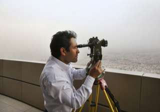 Iranian expert Alireza Fazaeli searches the sky for the new moon that signals the start of the Muslims' holy fasting month of Ramadan on top of the landmark, the Milad telecommunication tower, in Tehran, Iran. Millions of Muslims around the world marked the start of Ramadan, a month of intense prayer, dawn-to-dusk fasting and nightly feasts.