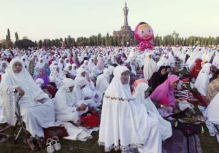 Muslim women attend an Eid al-Fitr prayer marking the end of the holy fasting month of Ramadan in Bali, Indonesia.