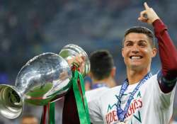 Ronaldo proudly holds the trophy at the end of the Euro 2016