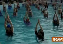 1000 women practice water yoga