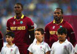 Jason Holder and Chris Gayle of the West Indies look on