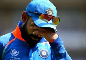 Virat Kohli of India looks on dejected during the ICC- India Tv