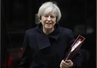 May leaves 10 Downing Street in London to attend...