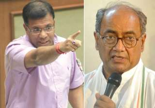 File pic of Vishwajit Rane and Digvijaya Singh -...