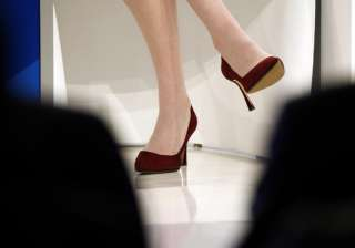 UK lawmakers debate on whether high heel dress...