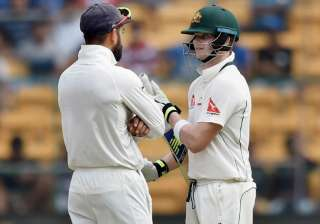 Virat Kohli with Steven Smith during the second...