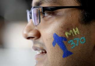 File pic - A man with a painted face attend Day...