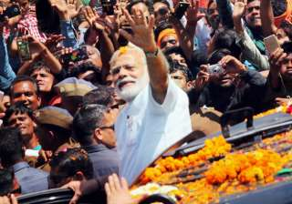 PM Narendra Modi during a road show in Varanasi ...