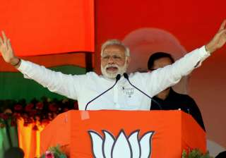 PM Modi to hold roadshow in Varanasi today -...