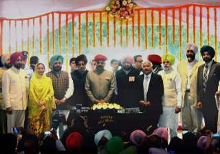 Punjab Guv with CM Amarinder Singh and his nine...