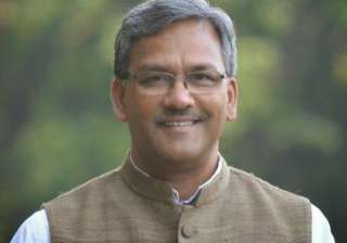 BJP picks Trivendra Singh Rawat as new...
