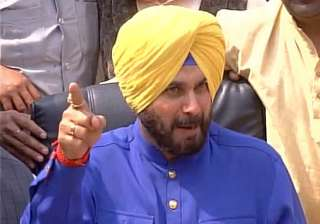 Congress leader Navjot Singh Sidhu speaks to...