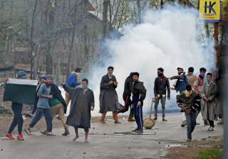 Youth pelting stones on security forces during...