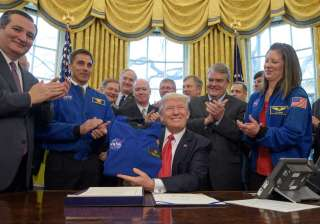 Trump signs NASA funding bill, sets goal of human...