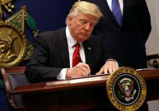 Donald Trump signs order to roll back Obama's...