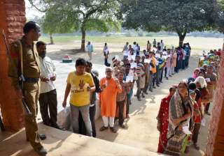 People at a polling booth to cast their vote in...