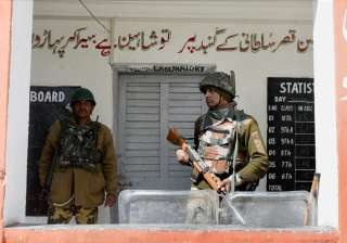 A jawan stand guard outside a polling station for...
