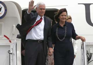 Mike Pence with his wife Karen arrive at US...