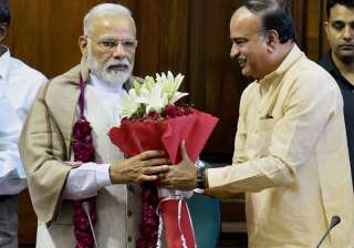 PM being greeted by Ananth Kumar to thank him for...