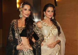 Malaika and Amrita sizzles in this magazine cover...