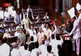 Opposition members protest in Rajya Sabha over...