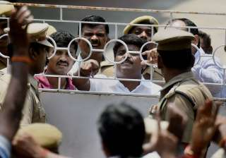 Minister Vijaya Baskar argues with police during...