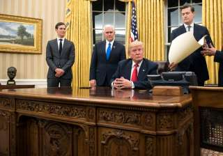 Trump signs executive order to stop 'misuse'...