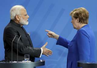 PM Modi backs Merkel's leadership as Trump...
