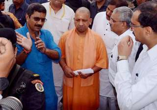 Adityanath being briefed about the bridge made on...