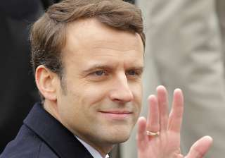 French president-elect Emmanuel Macron waves...