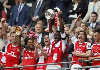 Arsenal players celebrate after winning FA Cup...