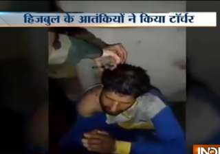Video shows suspected Hizbul militants torturing,...