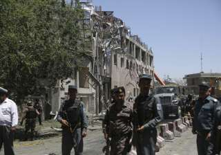 Security forces near the site of a suicide attack...