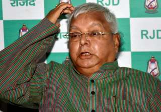 Lalu addressing a press conference at his...