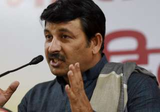 Manoj Tiwari addresses a press conference in New...