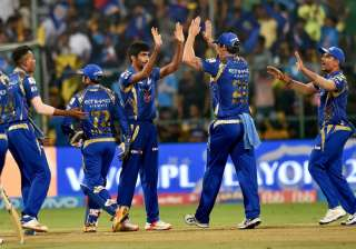 MI players celebrate during an IPL match in...