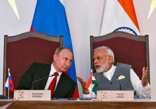 File pic of Russian President Putin and Indian PM...