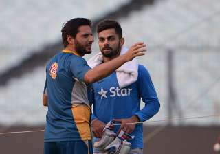 A file image of Shahid Afridi and Virat Kohli. -...