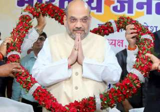 Amit Shah being garlanded during a meeting with...