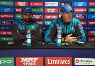 Pakistan captain Sarfraz Ahmed and coach Mickey...