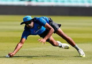 R Ashwin takes a catch during a net session. -...