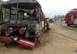 22 charred to death after bus collides with truck...
