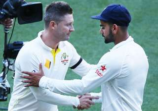 A file image of Michael Clarke and Virat Kohli. -...