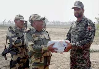 Jammu: BSF personnel exchange sweets with a...