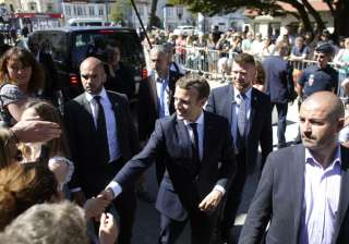 France's Emmanuel Macron faces test in...