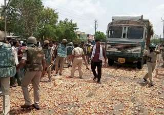 File pic - Farmers throwing vegetables on the...