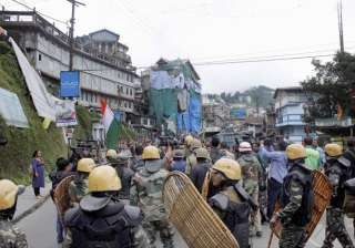 Security personnel during a protest by GJM in...