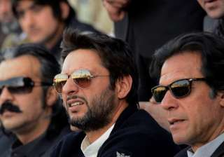 A file image of Imran Khan and Shahid Afridi. -...