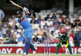 Virat Kohli plays a shot during the game against...